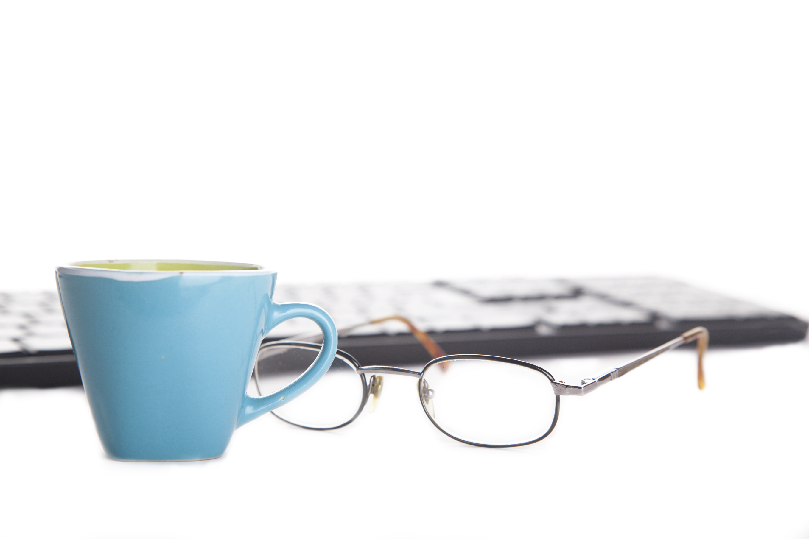 blue-cup-and-eyeglasses-isolated-000060055942_Large
